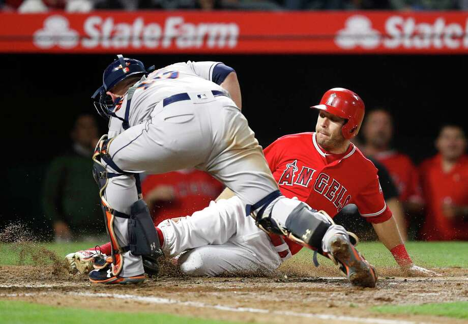 Los Angeles Angels' Ian Kinsler, right, is tagged out by Houston Astros catcher Brian McCann while trying to score on a single by Kole Calhoun during the seventh inning of a baseball game Tuesday, May 15, 2018, in Anaheim, Calif. (AP Photo/Jae C. Hong) Photo: Jae C. Hong, Associated Press / Copyright 2018 The Associated Press. All rights reserved.