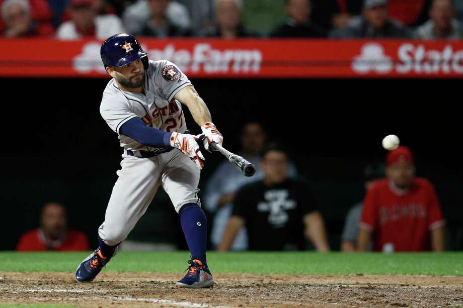 Houston Astros' Jose Altuve connects for a three-run double during the eighth inning of a baseball game against the Los Angeles Angels on Tuesday, May 15, 2018, in Anaheim, Calif. (AP Photo/Jae C. Hong) Photo: Jae C. Hong, Associated Press / Copyright 2018 The Associated Press. All rights reserved.