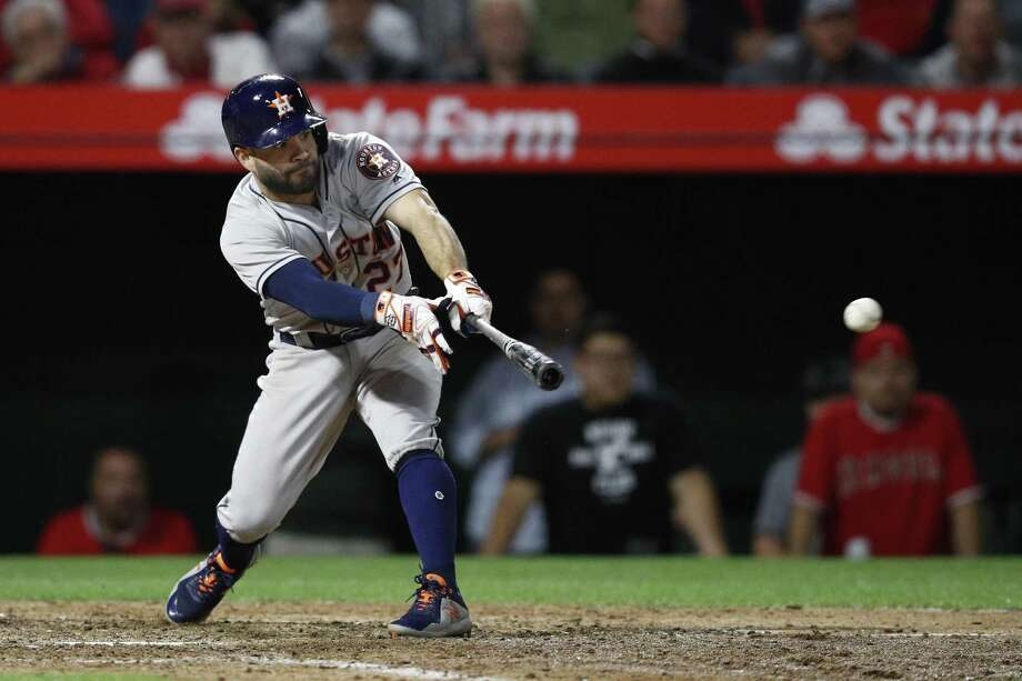 Jose Altuve reaches out to slap a three-run double into left field to turn the Astros' 3-1 deficit into a 4-3 lead in the eighth. Photo: Jae C. Hong, STF / Associated Press / Copyright 2018 The Associated Press. All rights reserved.