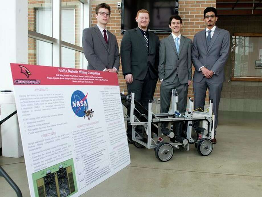 Four of the Saginaw Valley State University students who have designed a robot prototype for the NASA Robotics Mining Competition at the Kennedy Space Center in Florida this week pose for a photo. From left, Connor Peil, Erik King, Clayton Gould and Mohsen Abusaq; all are electrical engineering majors. (Photo provided/SVSU)