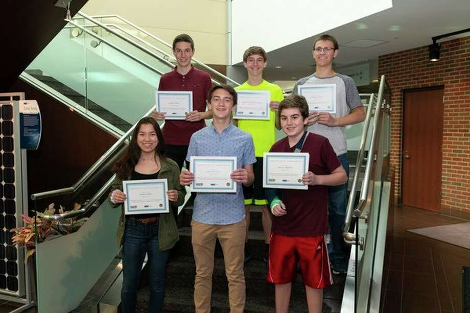 Midland students are recognized at Hemlock Semiconductor for earning scholarships to Michigan Technical University's Engineering Scholars Summer Youth Program. (Photo provided/Hemlock Semiconductor) / 2018 GLENN PHOTOGRAPHY
