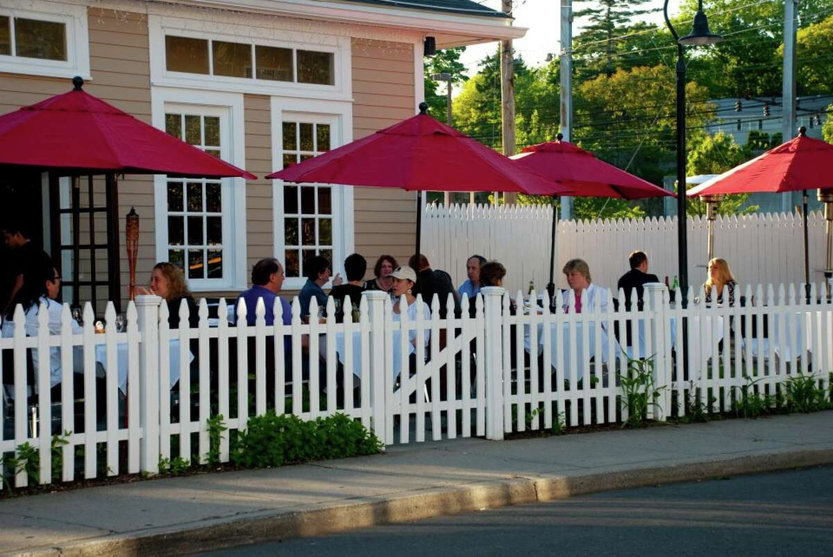 Enjoy American cuisine with a Mediterranean flair on the patio of 55 Wine Bar and Wood Grille in Fairfield.