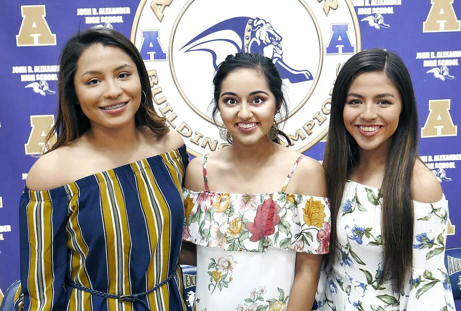A trio of Alexander softball players signed their National Letters of Intent on Tuesday in the AHS gym. Viri Hernandez, left, and Arianna Herrera, center, will play for Laredo Community College, while Sheila Hernandez joined TAMIU. Photo: Cuate Santos /Laredo Morning Times / Laredo Morning Times