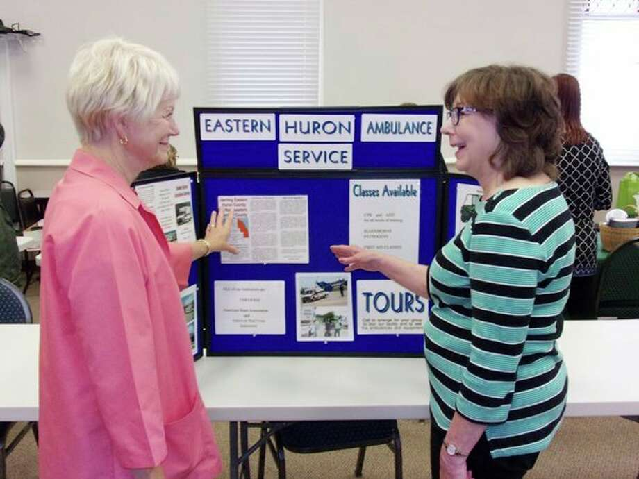 Jeanette Ginther discusses the Eastern Huron Ambulance Service with Mary Ann Godzwon at Harbor Beach Community Hospital's recent health fair. Free testing was available for area residents, and several vendors were on hand to offer advice and discuss products and services, during the health fair, which the Harbor Beach hospital holds annually. (Rich Harp/For the Tribune)