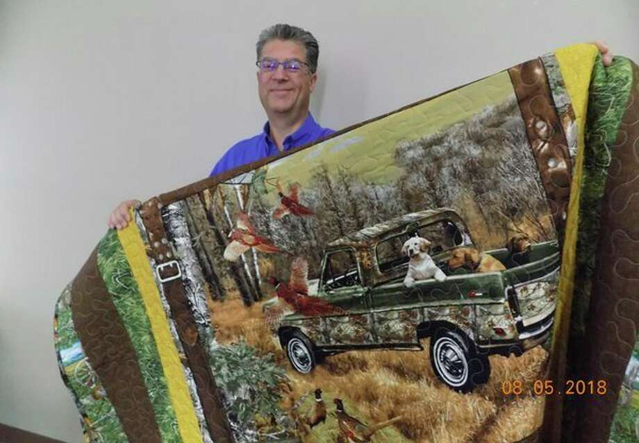 The Harbor Beach Hospital Foundation recently hosted its European Tower Pheasant Hunt fundraising event. Pictured is Vange Wolschleger, who made and donated this one-of-a-kind pheasant quilt for the event. The winner was David Dubriwny, who works in the radiology department at the Harbor Beach Community Hospital. (Submitted to the Tribune)