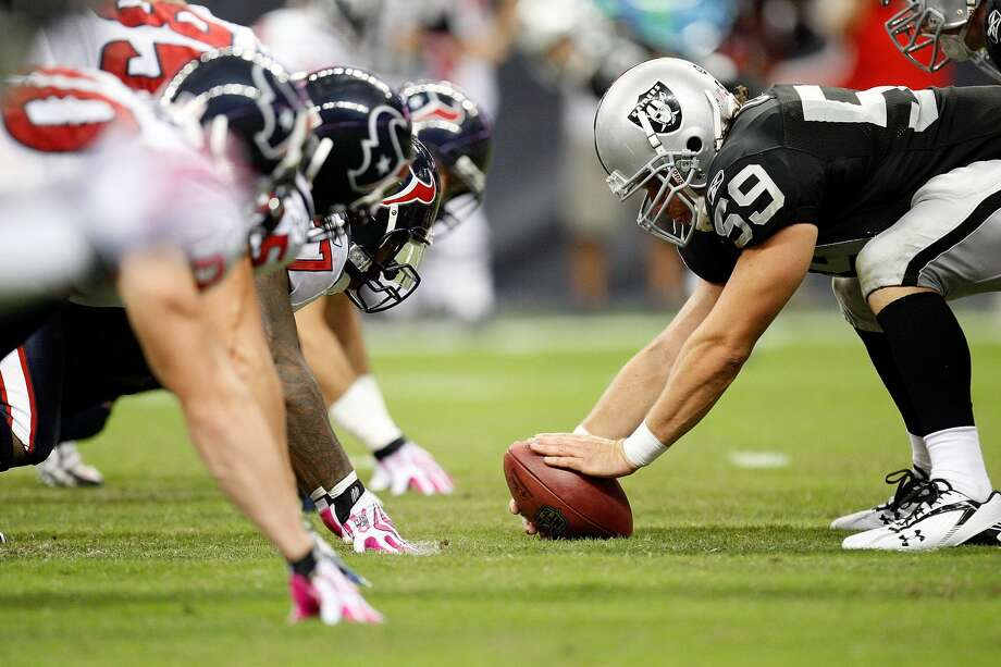HOUSTON - OCTOBER 04:  Center Jon Condo #59 of the Oakland Raiders at Reliant Stadium on October 4, 2009 in Houston, Texas.  (Photo by Ronald Martinez/Getty Images) Photo: Ronald Martinez/Getty Images