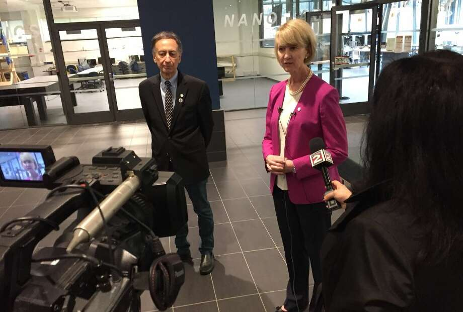 SUNY Chancellor Kristina Johnson, right, talks with reporters Tuesday along with SUNY Polytechnic Institute's interim president Bahgat Sammakia at the school's Utica campus on Tuesday Photo: SUNY