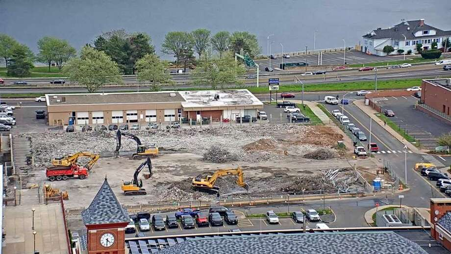 Demolition of the city's parking arcade off Court Street is 99 percent complete. Work began May 1 on the garage, which will be replaced by a single-floor gravel lot once work is complete. This photo is taken from the Middlesex Mutual building on Court Street. Photo: Contributed Photo