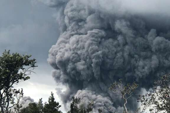 Kilauea's summit crater launched an ash plume into the air Tuesday, May 15, 2018.