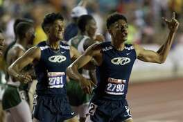 Klein Collins' Marlon Hardeman, right, and Jonathan Ventura react after winning the Class 6A boys 4x400-meter relay during the UIL State Track & Field Championships at Mike A. Myers Stadium, Saturday, May 12, 2018, in Austin.