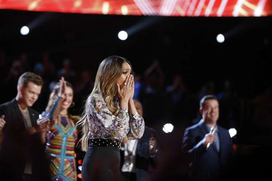 "Spensha Baker of San Antonio is stunned to hear her name called out first as one of the final four on NBC's ""The Voice."" She advances to next week's finale, which will decide the winner of a record deal and $100,000. Photo: Trae Patton /NBC / 2018 NBCUniversal Media, LLC."