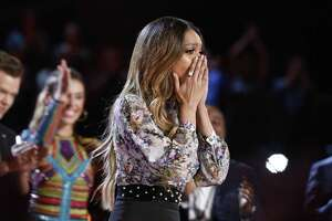 "Spensha Baker of San Antonio is stunned to hear her name called out first as one of the final four on NBC's ""The Voice."" She advances to next week's finale, which will decide the winner of a record deal and $100,000."