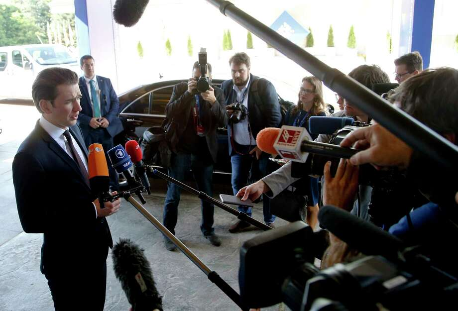 Austrian Chancellor Sebastian Kurz, left, speaks with the media as he arrives for a meeting of the EPP at a hotel in Sofia, Bulgaria, Wednesday, May 16, 2018. Heads of State of the EU and Western Balkan countries will attend a dinner on Wednesday and meet for a summit at Sofia's National Palace of Culture on Thursday. Photo: Darko Vojinovic, AP / Copyright 2018 The Associated Press. All rights reserved.
