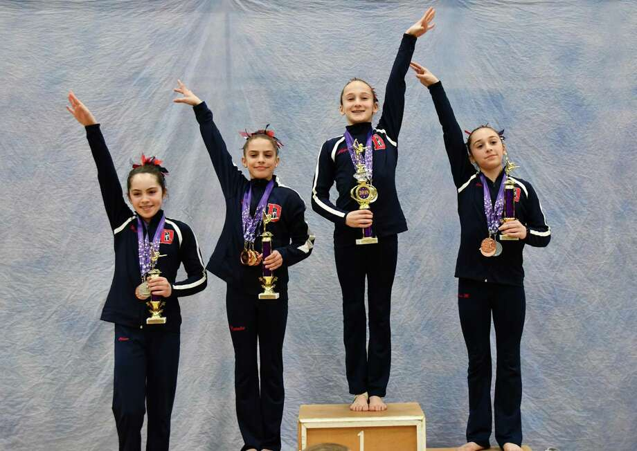 Darien Level 7 gymnast Abigail Nevin scored a perfect 10 on floor to win the All Around title at the 2018 YMCA Connecticut State Championship meet in Southington. Sweeping the podium with her were Olivia Perkins, fourth; Natalie Solis, second; and Anna Moss, third. Photo: Contributed Photo / Darien News contributed