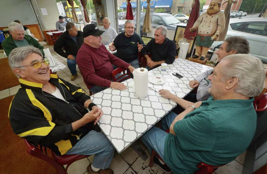 Dominck Muro, owner of Muro's New York Bakery and Deli, center, chats with his customers, Jimmy Patchen, Pete Rizzo, Tony Guaglione, Frank Marini and Stan Remson, at his establishment Wednesday, May 16, 2018, on Main Street in Norwalk, Conn. The bakery, a downtown staple in Norwalk for 66 years, will soon close its doors. Photo: Erik Trautmann / Hearst Connecticut Media / Norwalk Hour