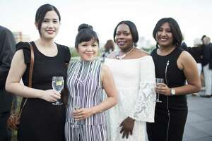Guests attend the Glassell School of Art cocktail party.