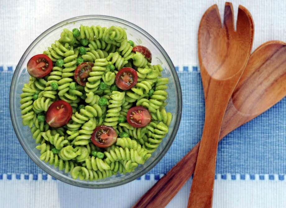 4. Skip the mayo-based salads: First, some facts. Despite its reputation as a par excellence incubator of food borne illness, most commercially produced mayonnaise is made with pasteurized eggs and loaded with preservatives. That doesn't make warm mayo any less gross. Try our Creamy Avocado Pasta Salad (pictured, see recipe below) instead. Photo: Paul Stephen /San Antonio Express-News