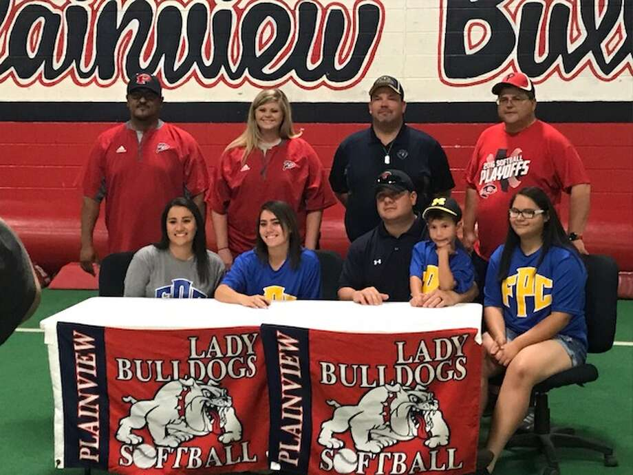 Plainview High Lady Bulldog Justus DeLeon signed Saturday, May 12, to play softball at Frank Phillips College in Borger. On hand for the signing ceremony are mom Jennifer DeLeon (seated left), Justus, father Chris DeLeon, brother Brody and sister Chloe, PHS assistant coach Enrique Villa (standing left),  PHS assistant coach Kami Carnell, Frank Phillips head coach Lucas Grider and PHS head coach Johnny Hill.