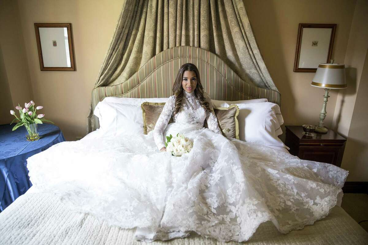 Meghan Markle doppelganger Leah Cast models an Isabelle Armstrong gown from Ivory Bridal Atelier, jewelry from I.W. Marks and a JoyBox Fine Flowers bouquet at Hotel Granduca.