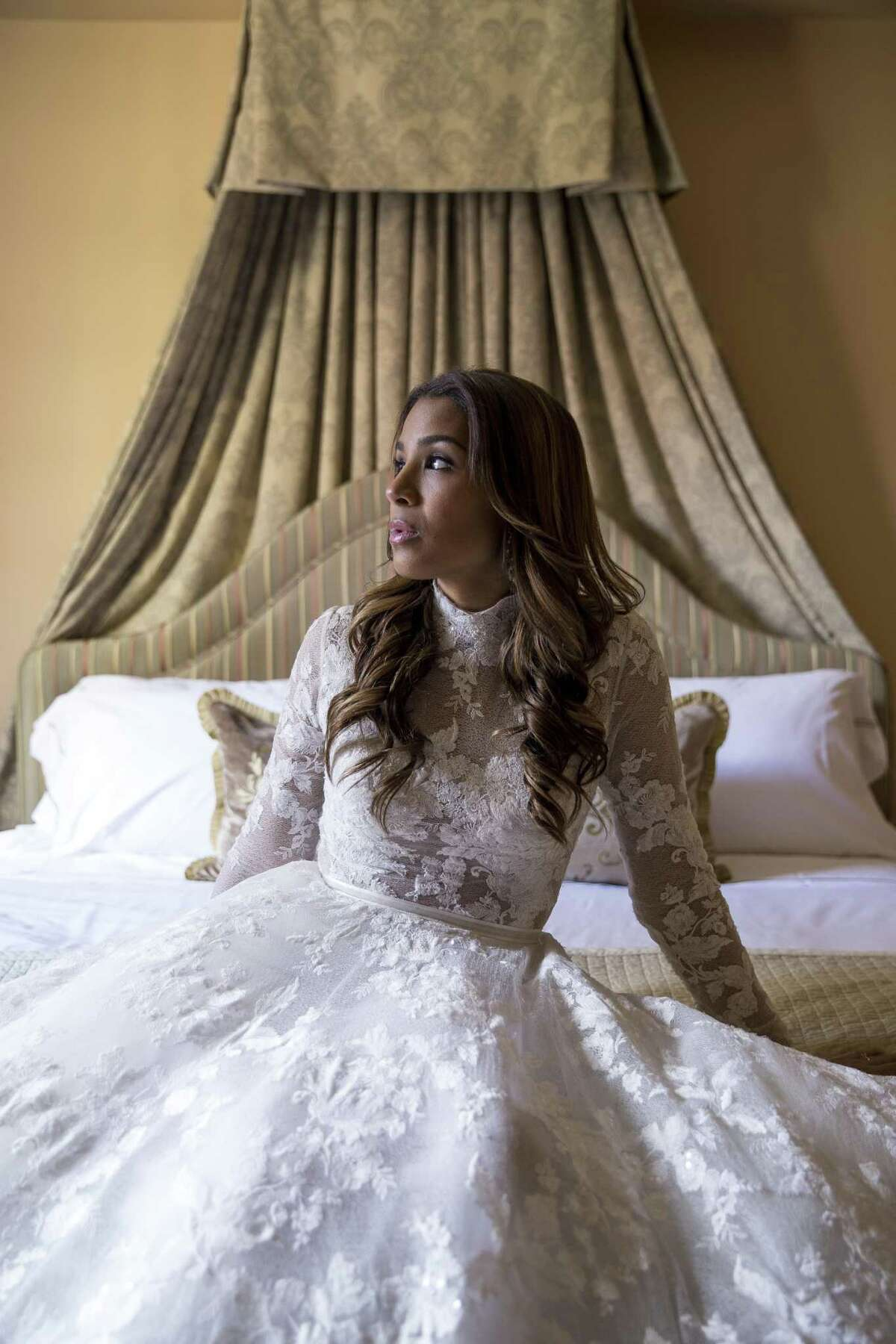 Leah Cast models an Isabelle Armstrong gown from Ivory Bridal Atelier and jewelry from I.W. Marks at Hotel Granduca.