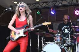 "Serbian singer, songwriter and guitarist Ana Popovic is shown entertaining a large crowd with her music at the Meriden Daffodil Festival in Hubbard Park on April 28. Ana recently released a triple album titled ""Trilogy"", which featured multiple special guests including Joe Bonamassa, Robert Randolph, Cody Dickinson (North Mississippi Allstars), Bernard Purdie and rapper Al Kapone. To learn more, go to www.anapopovic.com"