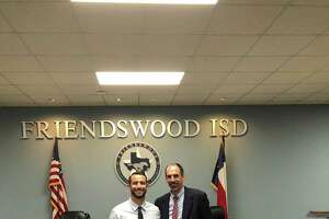 Cory Benavides (left) has been hired as the new head baseball coach at Friendswood High School. Benavides is shown with Friendswood ISD superintendent Thad Roher.