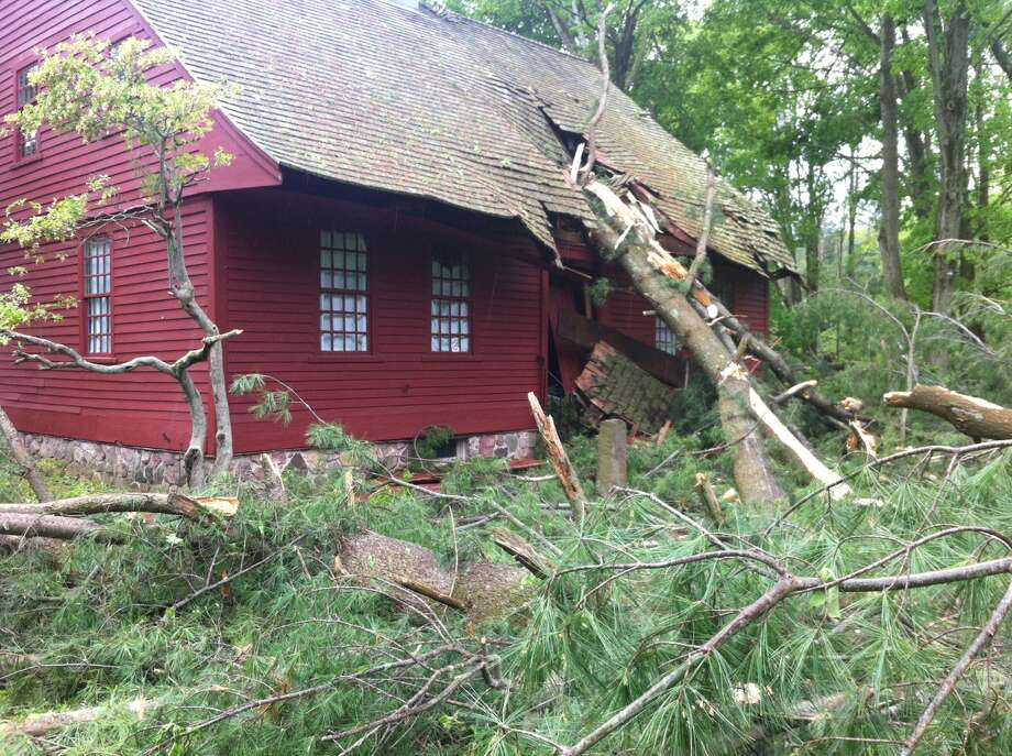 A tree fell on the historic Dickerman House on Mt. Carmel Avenue in Hamden during Tuesday's storm. Photo: Arnold Gold / Hearst Connecticut Media