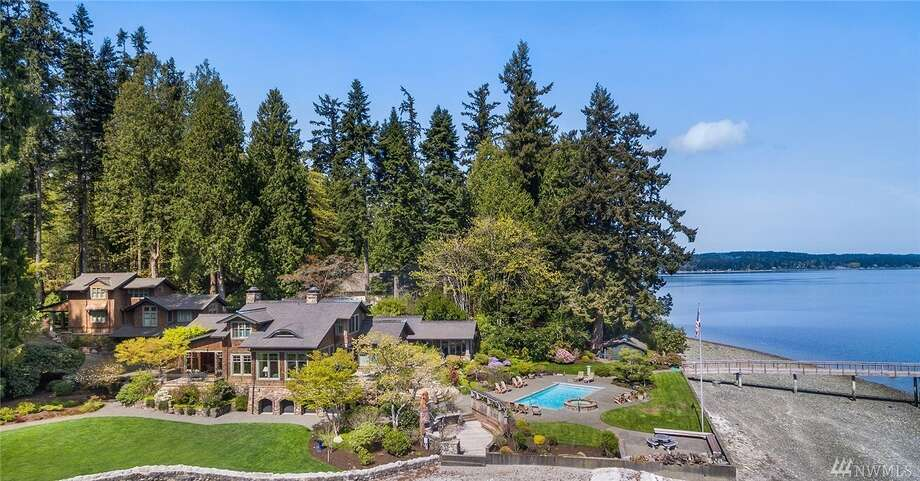 12269 Arrow Point Loop N.E., listed for $7,498,000. See the full listing below. Photo: Listed By Theresa Evans • Windermere RE Bainbridge