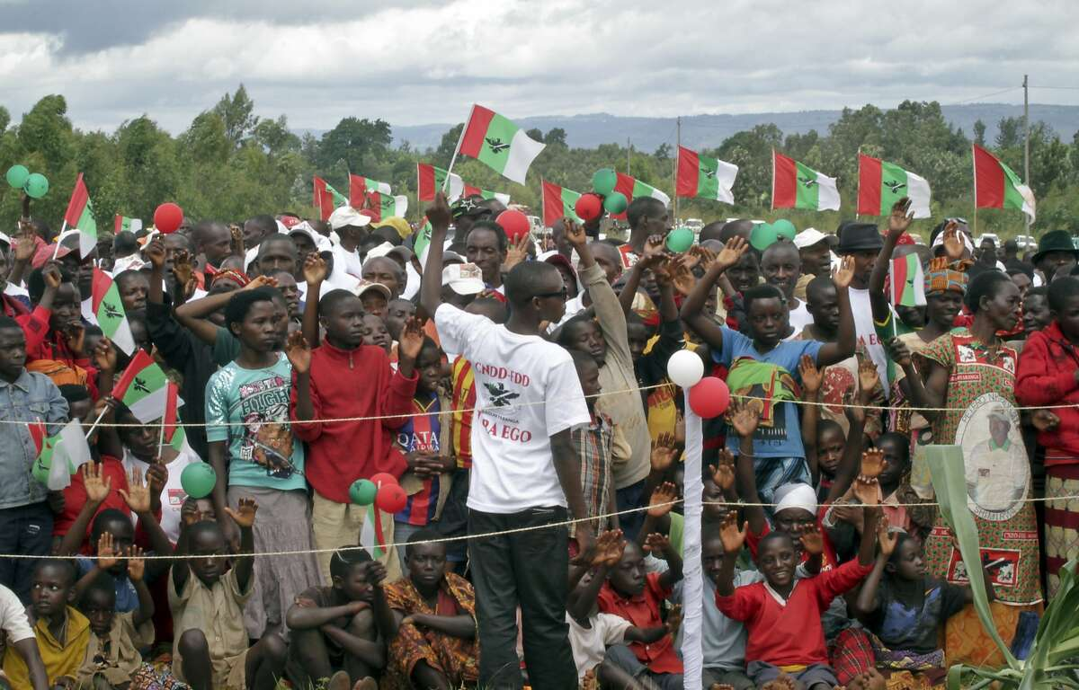 """FILE - In this Wednesday, May 2, 2018 file photo, Burundians attend a ruling party rally to launch its campaign calling for a """"Yes"""" vote in the upcoming constitutional referendum, in Bugendana, Gitega province, Burundi. Burundians vote Thursday, May 17, 2018 in a referendum that could keep the president in power for another 16 years and threatens to prolong a political crisis that has seen more than 1,000 people killed and hundreds of thousands fleeing the country. (AP Photo, File)"""