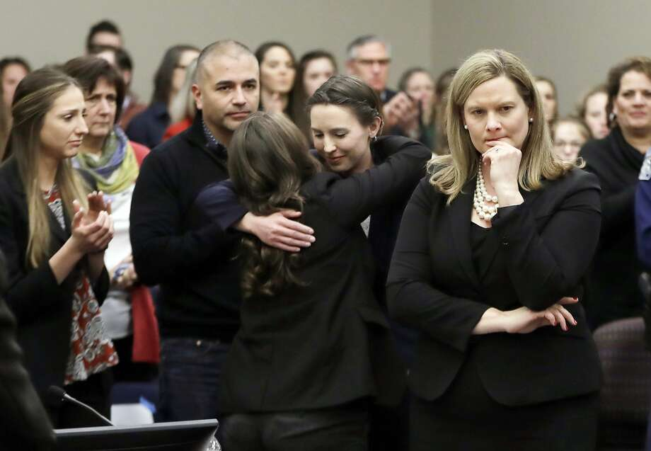 Former gymnast Rachael Denhollander (center) is hugged after giving her victim impact statement during Larry Nassar's sentencing hearing in January in Lansing, Mich. Photo: Carlos Osorio / Associated Press