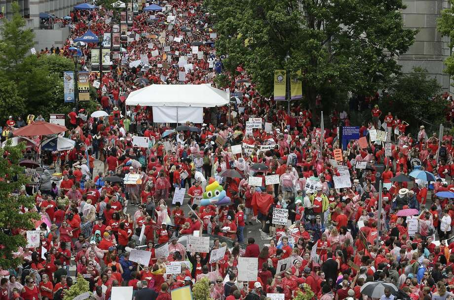 Teachers fill Bicentennial Plaza during a rally for raises and resources Wednesday at the General Assembly in Raleigh, N.C. Photo: Gerry Broome / Associated Press