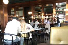 The interior of Henry's has been refurbished but the redwood bar has a classic look