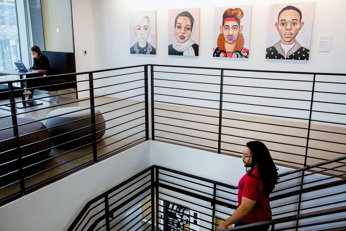 Instagram concept art lead Donald Welch heads down the stairs at the Instagram office space at 181 Fremont Street, Tuesday, May 15, 2018, in San Francisco, Calif.