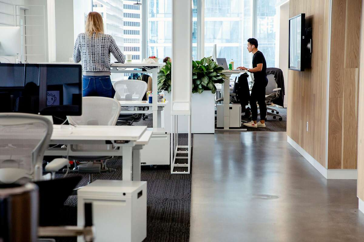 Instagram product designer Min Zhou (right) works at the Instagram offices at 181 Fremont Street, Tuesday, May 15, 2018, in San Francisco, Calif.