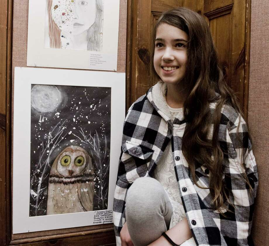 Isla Callahan, fourth-grader at Rowayton Elementary School, with her chalk pastel owl at the Norwalk Public Schools art show opening in the community room of City Hall. Tuesday, May 15, 2018 Photo: Scott Mullin / For Hearst Connecticut Media / The News-Times Freelance