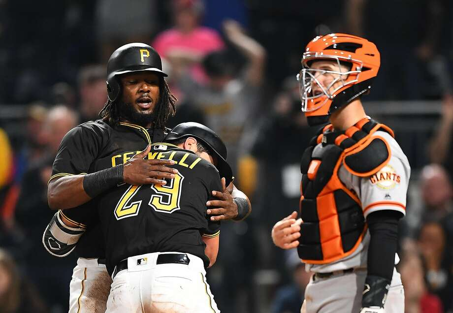PITTSBURGH, PA - MAY 12:  Francisco Cervelli #29 celebrates with Josh Bell #55 of the Pittsburgh Pirates after hitting a two run home run in front of Buster Posey #28 of the San Francisco Giants during the sixth inning at PNC Park on May 12, 2018 in Pittsburgh, Pennsylvania. (Photo by Joe Sargent/Getty Images) Photo: Joe Sargent / Getty Images