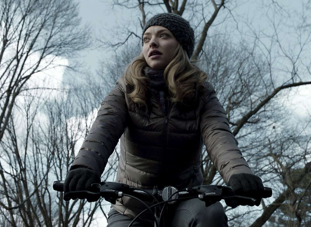 """This image released by A24 shows Amanda Seyfriend in a scene from """"First Reformed."""" (A24 via AP)"""