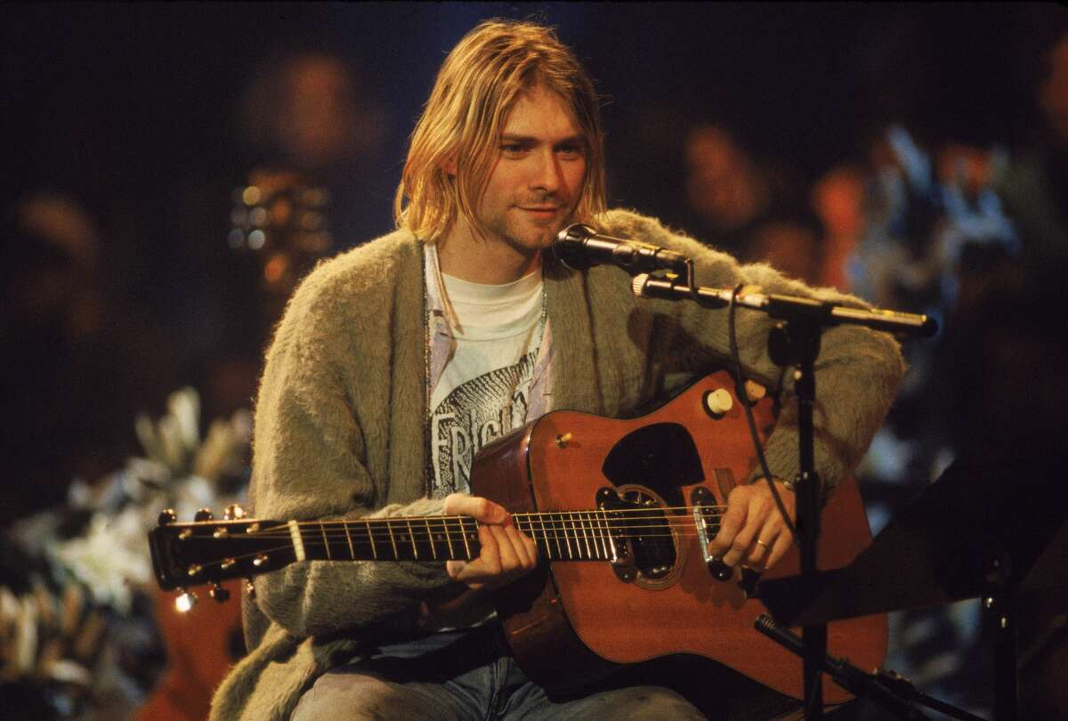 American singer and guitarist Kurt Cobain (1967 - 1994), performs with his group Nirvana at a taping of the television program 'MTV Unplugged,' New York, New York, Novemeber 18, 1993. The sweater is now up for auction.