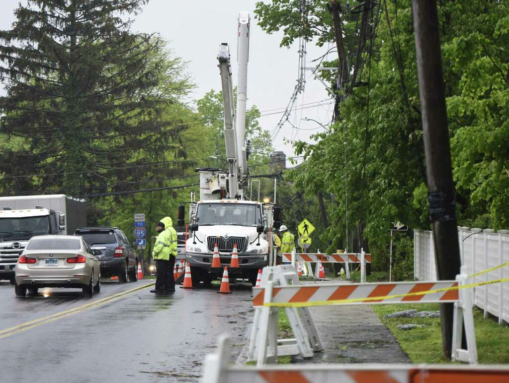 Crews close a lane to clean up storm damage on Field Point Road in Greenwich, Conn. Wednesday, May 16, 2018. Greenwich saw strong winds during Tuesday's storm causing road closures and power outages throughout town. Photo: Tyler Sizemore / Hearst Connecticut Media / Greenwich Time