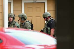 Fort Bend County Sheriffs Office SWAT team at the scene where a man is barricaded at Willow Lake Apartments, after allegedly killing his wife Monday, May 14, 2018, in Katy, Texas. FBCSO received a call reporting that a man had killed his wife and would kill himself.