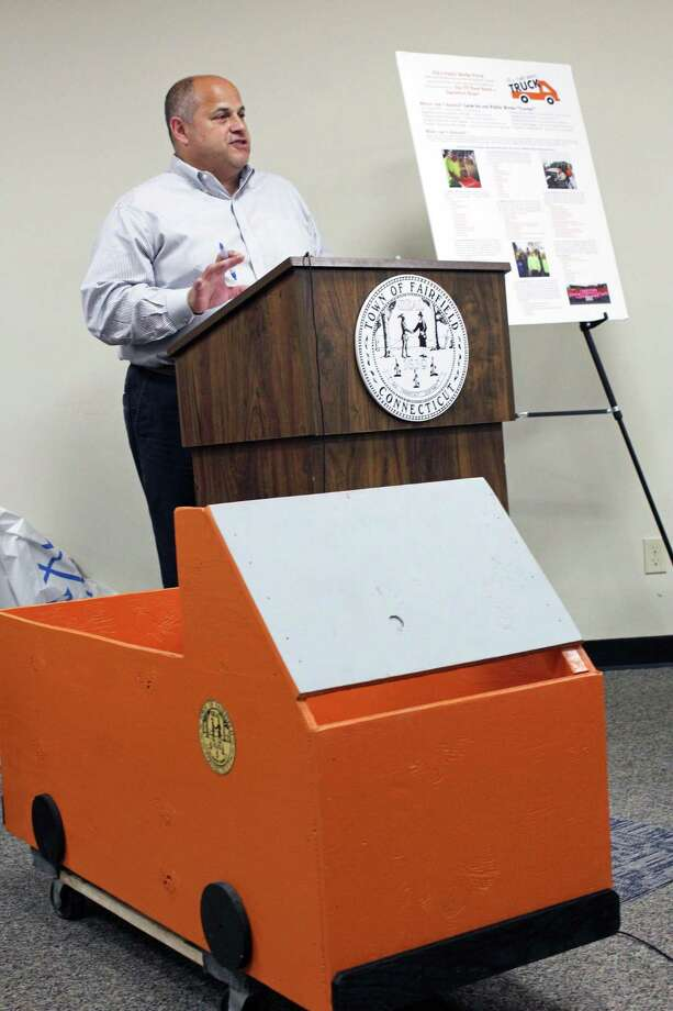 "Public Works Director Joseph Michelangelo unveils the collection boxes resembling trucks for the DPW's ""Fill a Public Works Truck"" food drive slated for May 20-26. Fairfield,CT. 5/16/18 Photo: Genevieve Reilly / Hearst Connecticut Media / Fairfield Citizen"