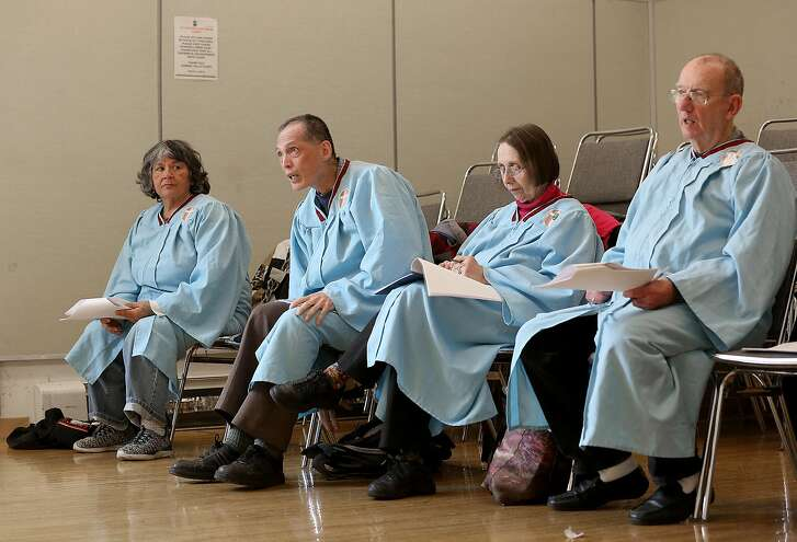 """Left to right--Vicki Anderson, Perry Tom, Helen Dannenberg, and Hugh O'Regan get ready before rehearsal of """"Barn Owl""""  at Eureka Valley recreation center on Monday, May 14, 2018 in San Francisco, Calif."""