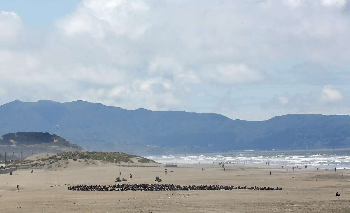 Some of the 500 children and 100 parents gathered at Ocean Beach to make a whale made up of participants for the 25th Annual Kids� Ocean Day Adopt-A-Beach Cleanup on Wednesday, May 16, 2018 in San Francisco, Calif.