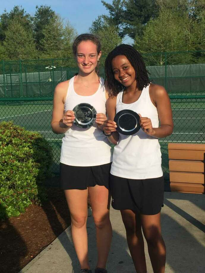 Megan Farrell, left, and Nia Foster of Sacred Heart placed second in the FAA doubles tournament held Monday at Greens Farms Academy. Photo: Contributed Photo