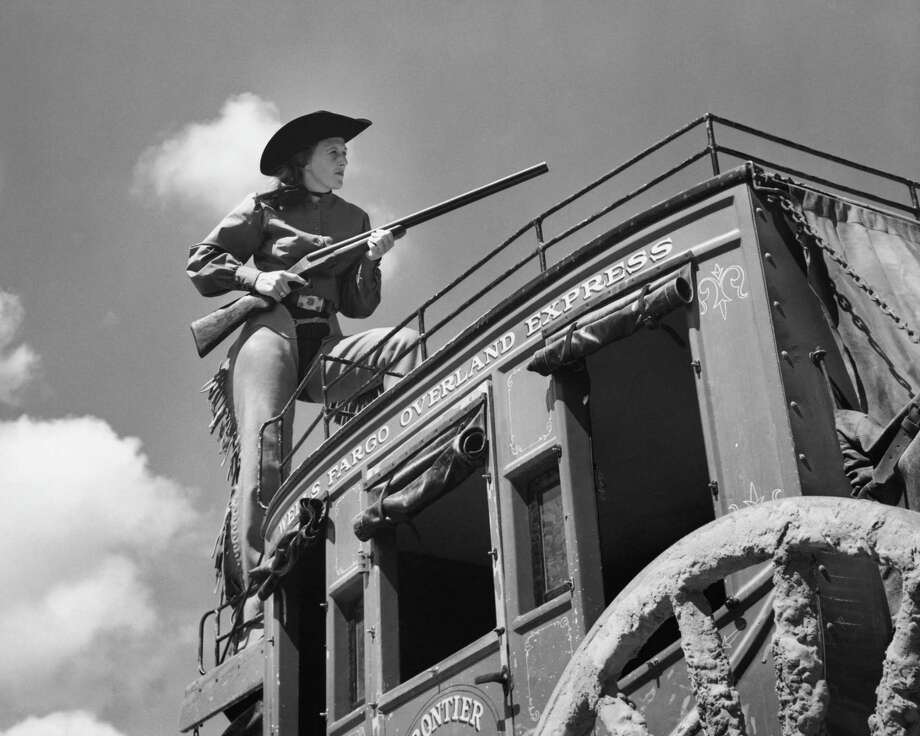 Calamity Jane riding shotgun on stage Photo: Getty Images / &#169 SuperStock, Inc.