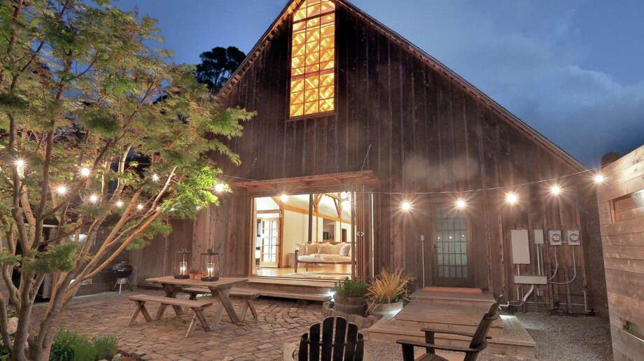A unique Bolinas property listed for $3.885 million includes a three-bedroom home with Mid-Century Modern style and a rustic 100-year-old barn with loads of country charm. Photo: Flying House Films