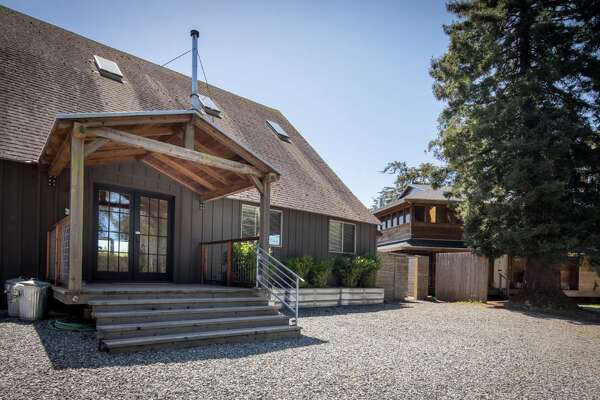 A unique Bolinas property listed for $3.885 million includes a three-bedroom home with Mid-Century Modern style and a rustic 100-year-old barn with loads of country charm.