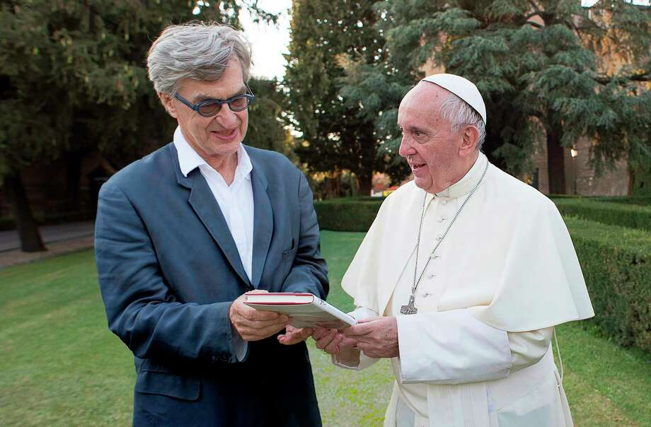 """This image released by Focus Features shows Pope Francis, right, with director Wim Wenders during the filming of the documentary """"Pope Francis: A Man Of His Word."""" (Focus Features via AP) / POPE FRANCIS - A MAN OF HIS WORD (c) 2018 CTV, Célestes, Solares"""