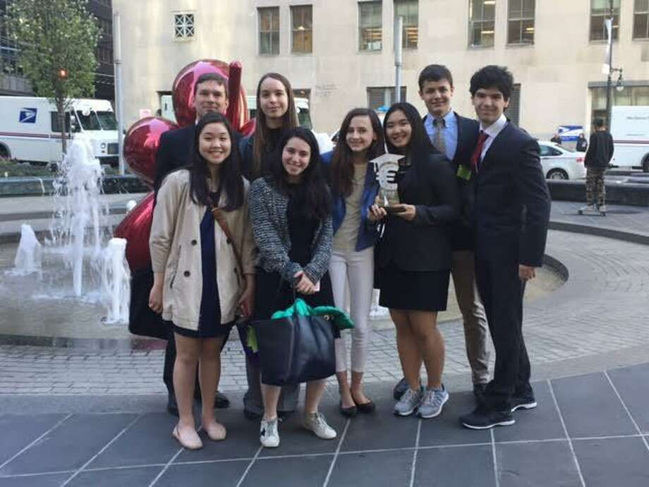 The team for the National Euro Challenge from Greenwich High includes, from left, back row: teacher-adviser Ian Tiedemann, Sofia Pronina; front row: Autumn Kim, Julia Blank, Wyatt Radzin, Melissa Woo, Matthew Meyers and Pietro De Ferrari. Photo: Contributed /