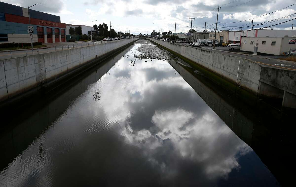 Water in Colma Creek flows downstream towards the bay in South San Francisco, Calif. on Wednesday, May 16, 2018. Teams of urban and environmental designers are collaborating to develop projects to limit the effects of climate change and sea level rise in 10 regions around the bay shoreline.
